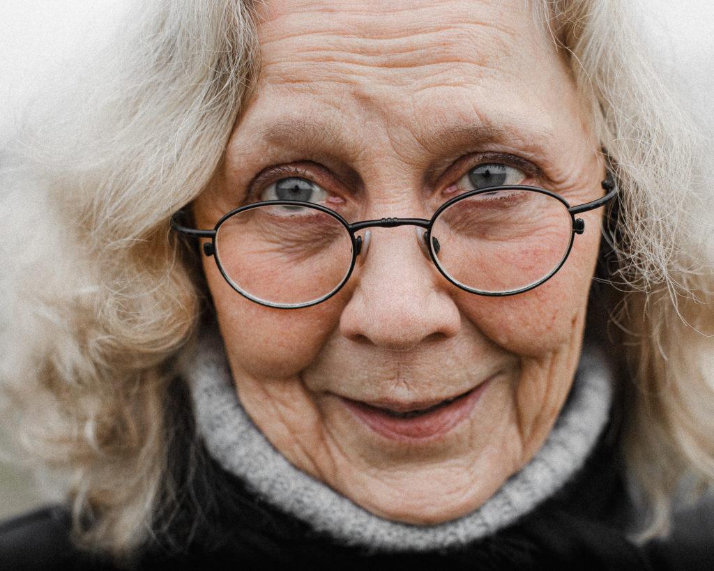 Close-up portrait of Gun-Britt Leck, wearing glasses.
