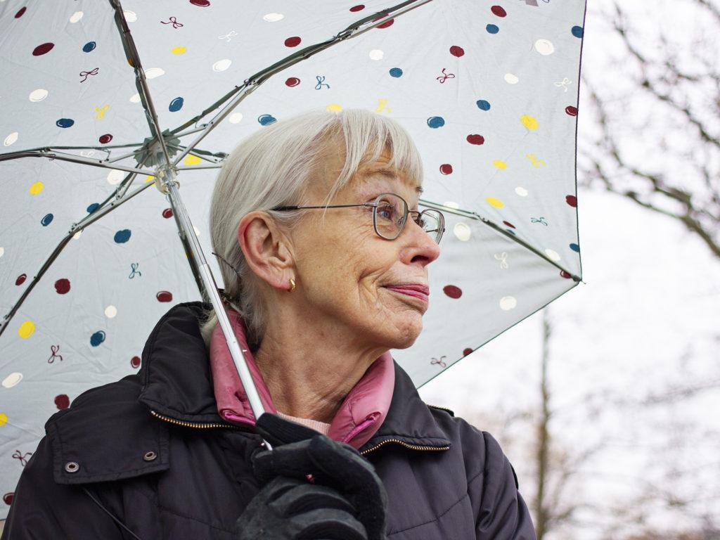 Birgitta Thulin outside under her umbrella